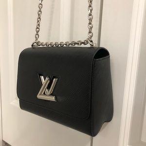 Louise Vouitton shoulder bag.
